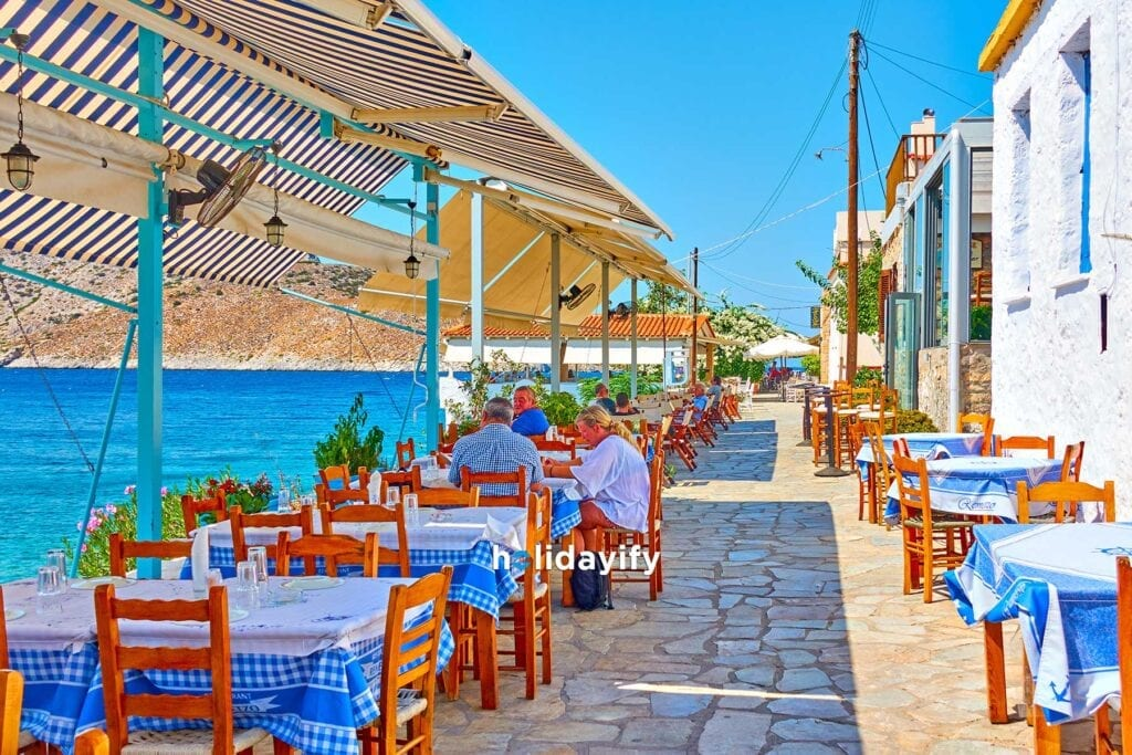 Seafood restaurant at waterfront by the sea in Perdika Aegina