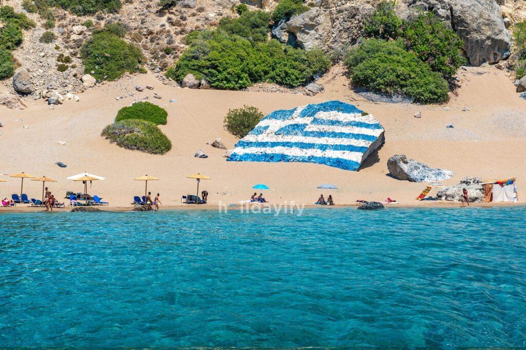 Greece Flag in Tsambika Beach, Rhodes
