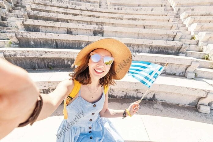 Tourist Girl with Greek Flag